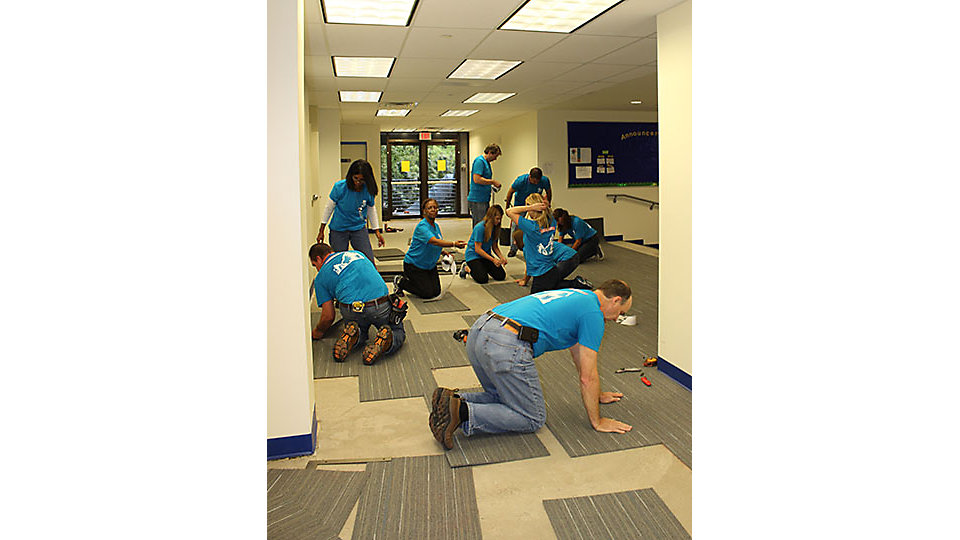 Interface volunteers installed carpet in the entrance way and chapel at Cristo Rey Atlanta Jesuit High School.