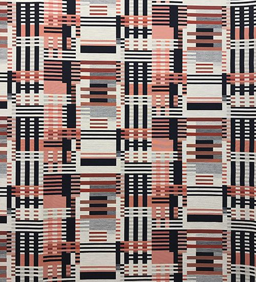 Bauhaus-inspired textile with black and grey and orange geometric pattern. Designtex