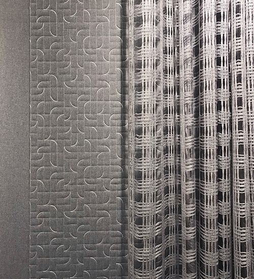 Three grey curtains transitioning from solid to subtle carving-like curves to loose weaves. Luum