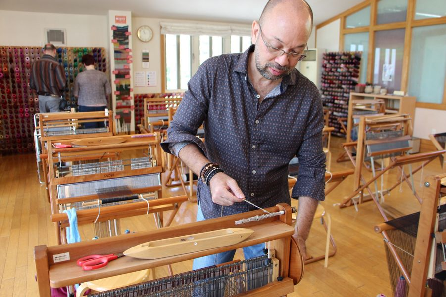 Daniel Blois working on a SAORI loom