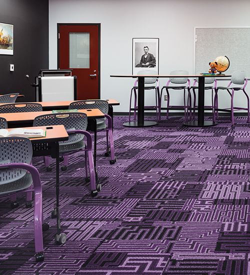 THINC Academy classroom with vibrant purple geometric carpet.