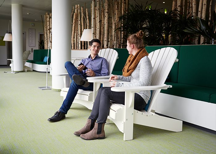 Two people speaking in an open, collaborative space in the Philips HQ in Hamburg, Germany.