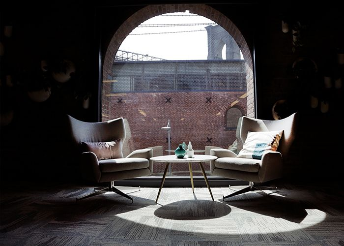 A secluded space at West Elm's HQ with plush armchairs and lots of natural light.