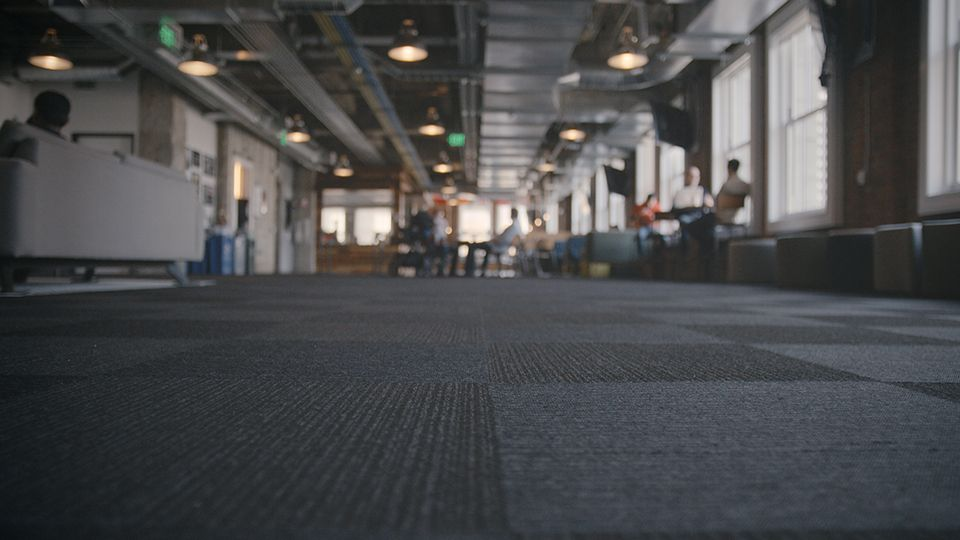 Yelp's headquarters feature Interface carpet tiles with a minimalistic appeal