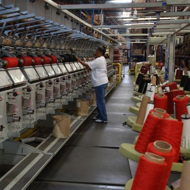 Premium branded yarn is sorted and prepared for the tufting process at RCA.