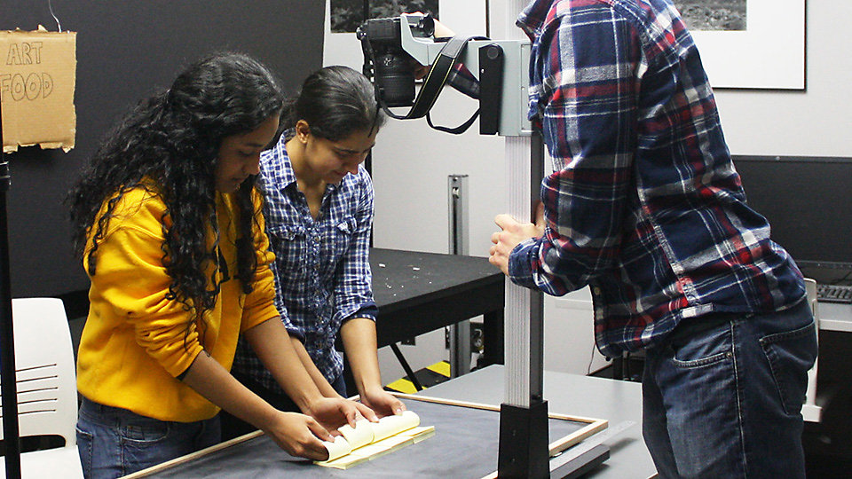 Students work on filming their stop motion animation.