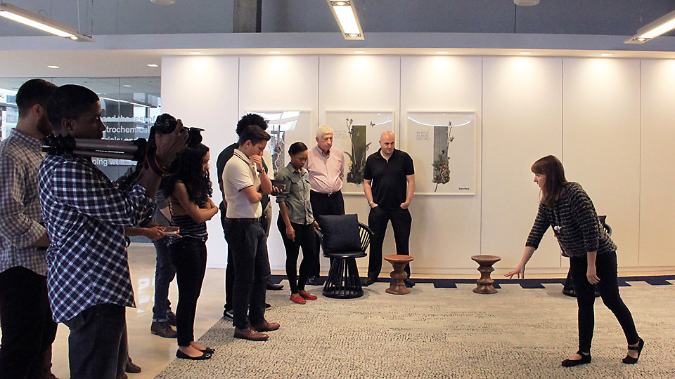 Product Stylist Gretchen Wagner leads students through the showroom's current skinny plank installations.