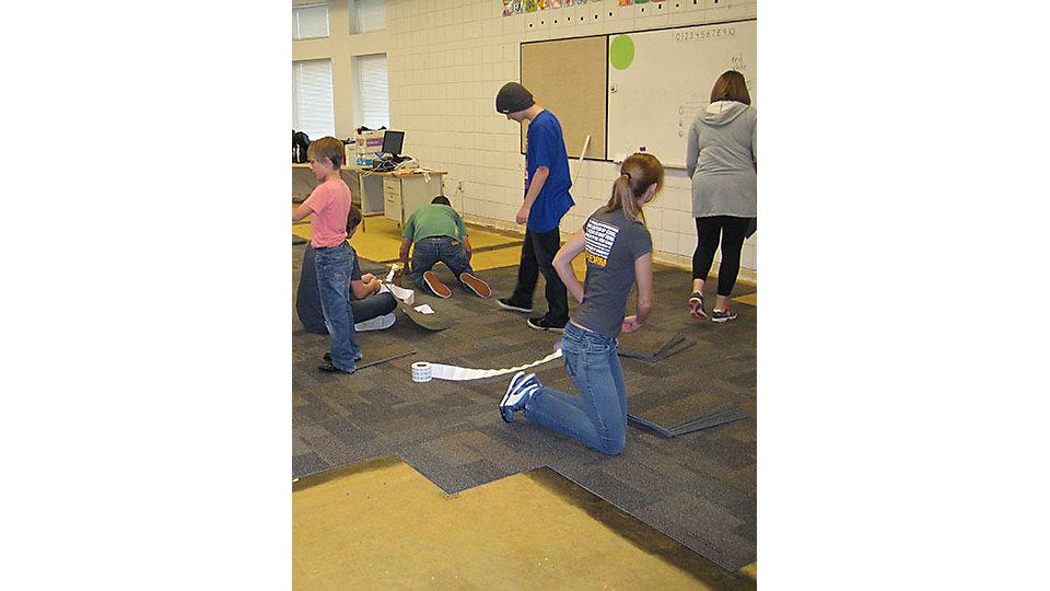 Interface associates installed carpet tile at Uintah Elementary in Utah with the help of a few small hands.