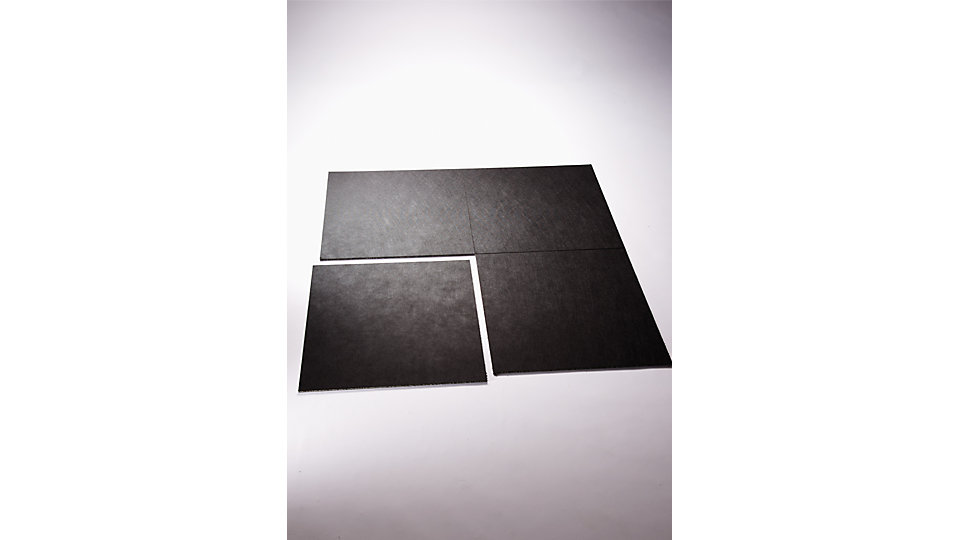 Interlay is a resilient, loose-lay underfloor system of 50 x 50 cm tiles