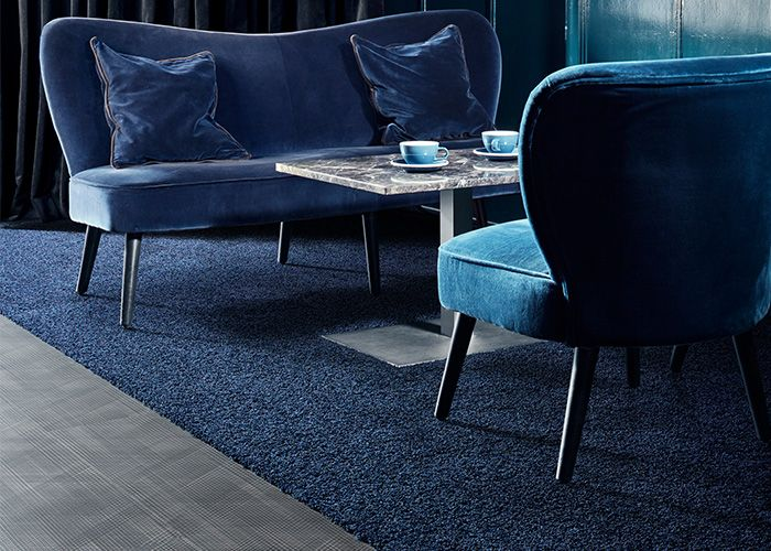 The use of darker shades to create a relaxing, cosy feel to the lounge area in a hotel. Products: Drawn Lines - Onyx, HN830 - Cobalt