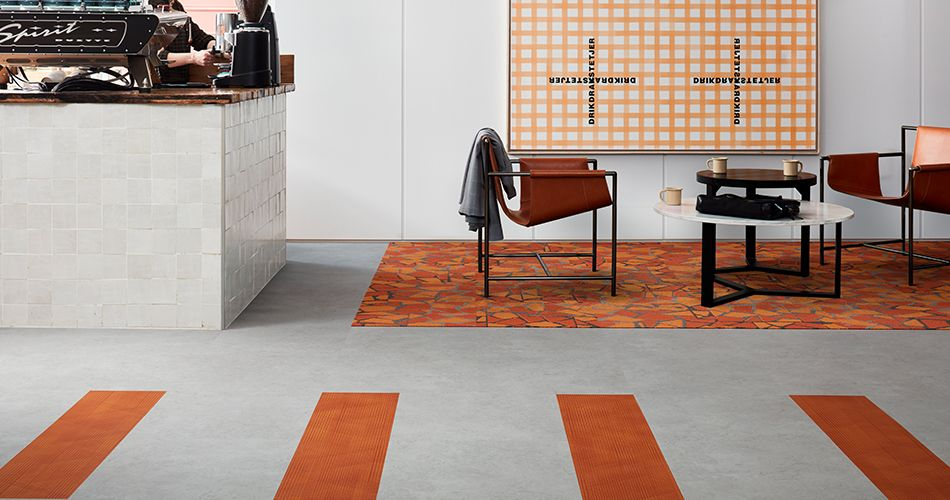 Using orange accents to energise in a hotel cafe. Products: Level Set – Light Concrete, Drawn Lines – Amber, Human Connections Rue - Orange